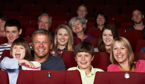 Happy families sitting in a theatre audience